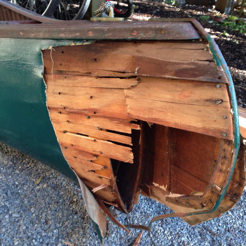 Damaged Greenwood Canoe